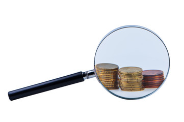 Magnifier and stack coins isolated on white.