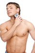 Portrait of a young handsome man shaving