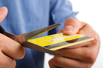 Man cutting a credit card