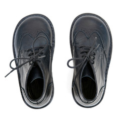 Pair of black Kid's shoes isolated on White.