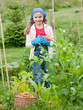 Gardening - little girl working in the vegetable garden