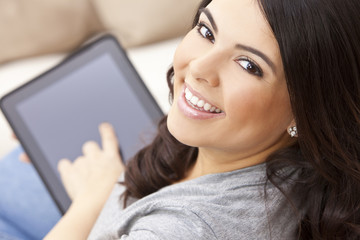 Happy Hispanic Woman Using Tablet Computer
