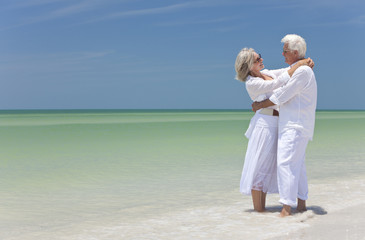 Happy Senior Couple Embracing on A Tropical Beach