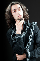 Man with metal chain around him