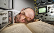 Exhausted scientist sleeping on book