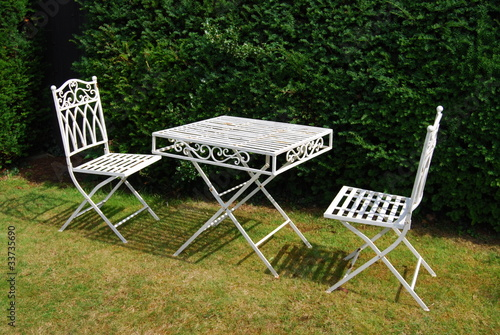 White metal garden furniture - table and two chairs