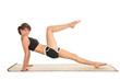 Frau beim Sport winkelt Bein an