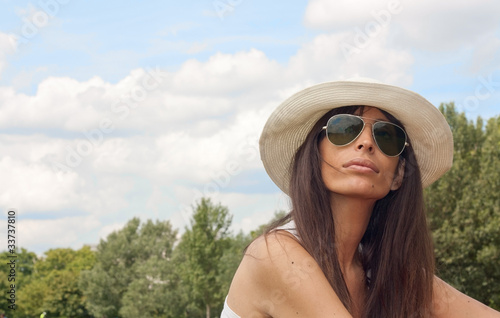 Attractive woman in the park on a sunny day
