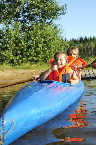 Sisters in kayak