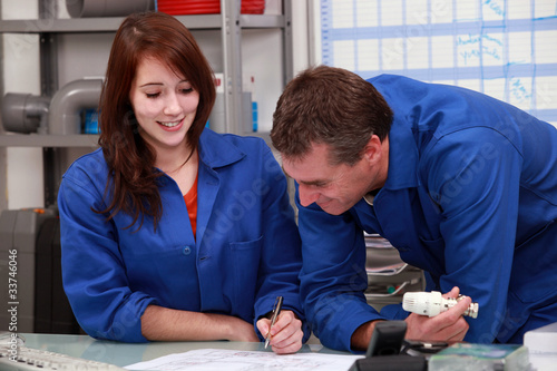 Workers writing on a desk