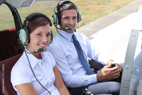 Man and woman in the cockpit of a light aircraft - 33746632