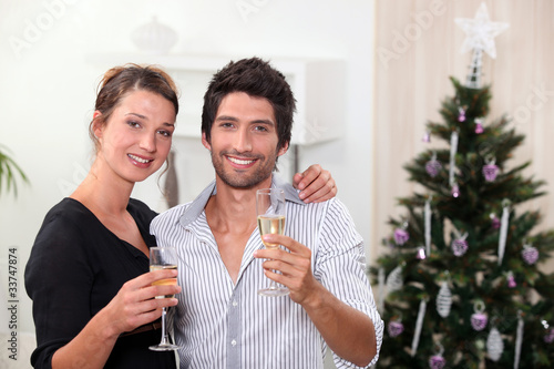 young couple celebrating New Year's Eve