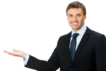 Businessman showing blank area for sign or copyspase, isolated