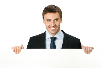 Happy business man showing blank signboard, isolated