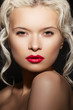 Beautiful woman with bright lips make-up, luxury curly hairstyle