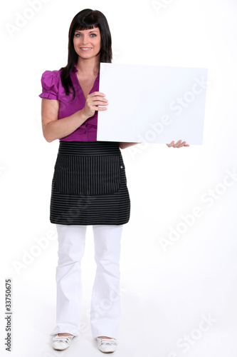 brunette holding a canvas