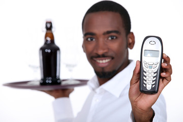 black wine waiter showing a telephone