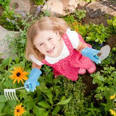 Little gardener in herbal garden