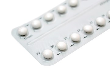 Birth control pills on white