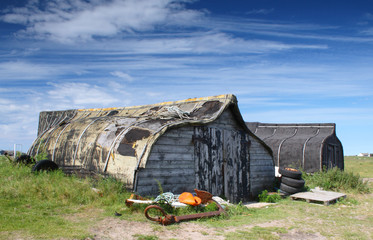 Upturned boats converted to sheds