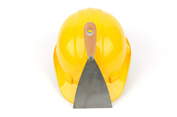 yellow industrial safety helmet and stainless steel scraper