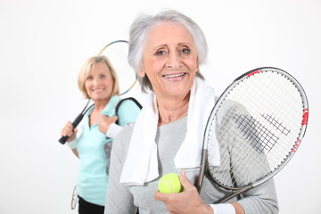 two senior women doing tennis