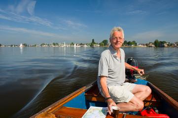 Elderly man in boat