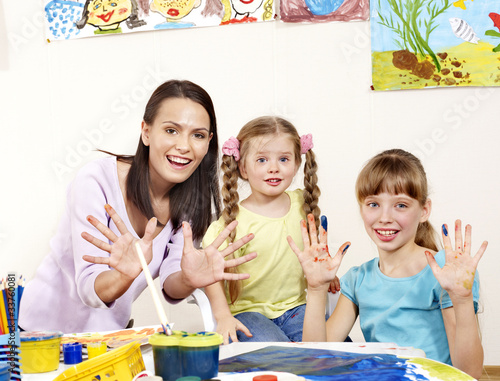 Child painting in preschool.