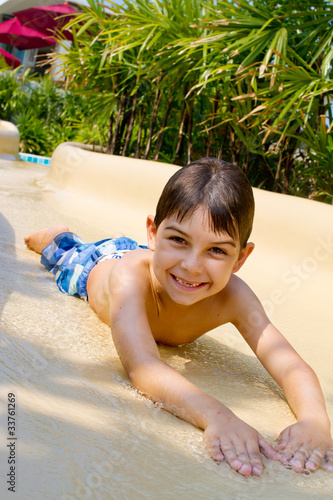 Boy Sliding Down Water Slide.