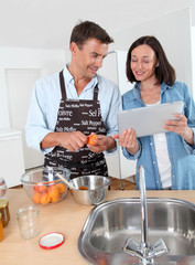 Couple cooking fruit jam at home