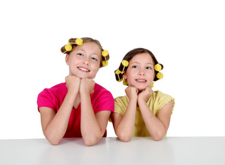 Portrait of young girls with hair curlers