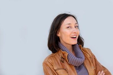 Portrait of smiling woman with turtleneck sweater