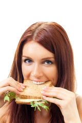 Hungry gluttonous woman eating sandwich, isolated on white