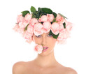 young woman in a hat of roses isolated on white