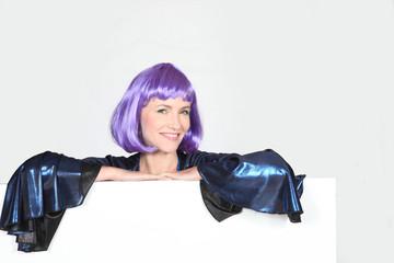 Disco diva in a very shiny purple wig