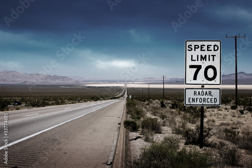 Highway road with speed limit sign - 33774685