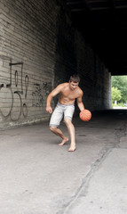 bare-chested guy playing basketball
