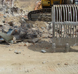 excavator and demolition rubble on an industrial construction si poster