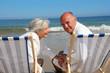Portrait of senior couple sitting in deckchairs