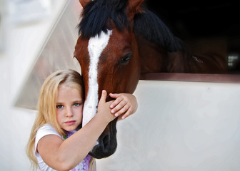 Girl hugging a horse