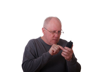 Older Balding Guy in Gray Shirt Trying to Dial a Phone