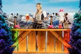 tiroler girl in the snow behind a bar