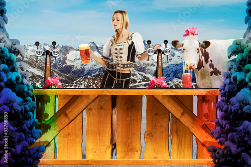tiroler girl in the snow behind a bar - 33788850