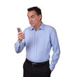Attractive Man in Blue Shirt Looking Startled at Phone
