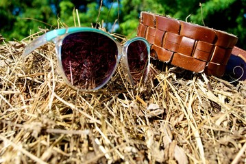 belt and sunglasses in tuscany compaign