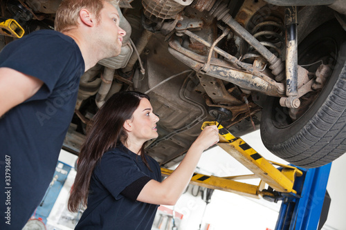 Two Mechanics Discussing Problem