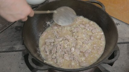 Cooking meat with onion for pilaf