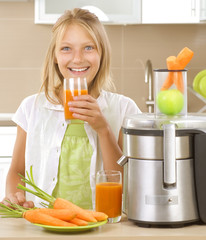 Girl drinking fresh carrot and apple juice. Healthy lifestyle