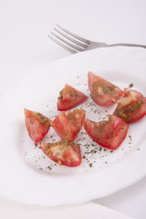fresh tomatos on the plate