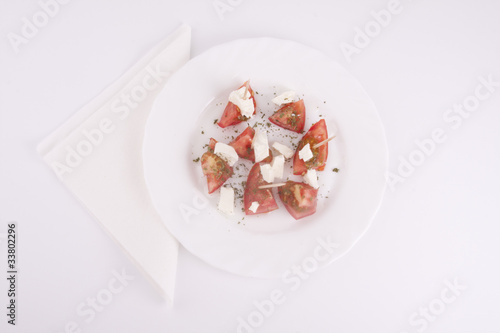 Feta Cheese and Tomato on the plate